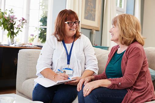 Female Social Worker Visits Senior Woman